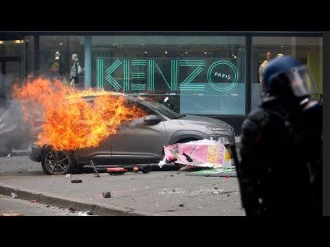 Yellow-vest protesters set fires, smash stores in Paris