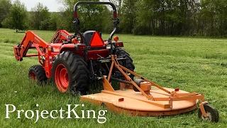 Kubota Tractor Cutting Grass with Bush Hog