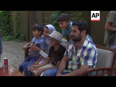 Afghan boy known as 'Little Picasso' shows works in Serbia