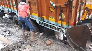 Tata 2518 Truck Stuck During Rainy Days Pushed By Jcb Backhoe Machine.
