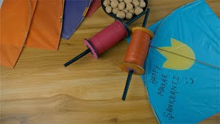 Closeup shot of rolling reel Charkhis on the kite festival of India - Makar Sankranti