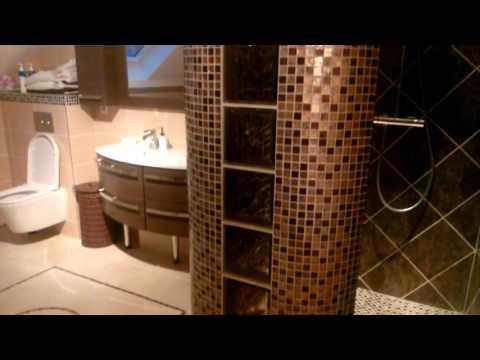 Salle de bain Design réalisée de A à Z.Comprenant cabine de douche incurvée en mosaïque