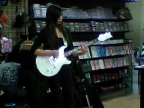 Slash (Girl guitarist) doing a