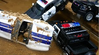 Police Cars-stuck in the mud go to the car wash