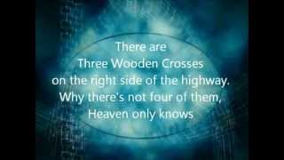 Three Wooden Crosses Lyrics - Three Wooden Crosses by Randy Travis with Lyrics
