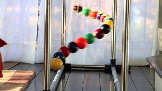A simple demo of order and chaos (and order again) - Home made Pendulum Wave with 15 billiard balls