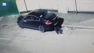 CCTV captures man placing GPS tracker on family's car in Manchester