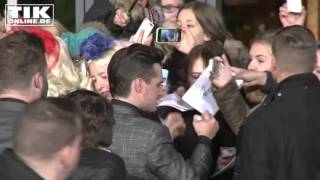 Josh Hutcherson surrounded by fans in Berlin
