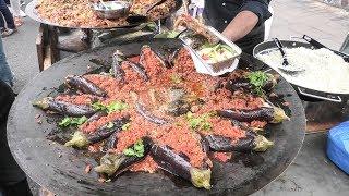 Huge Curry Pan with Eggplants. Street Food from Myanmar, Burma. London