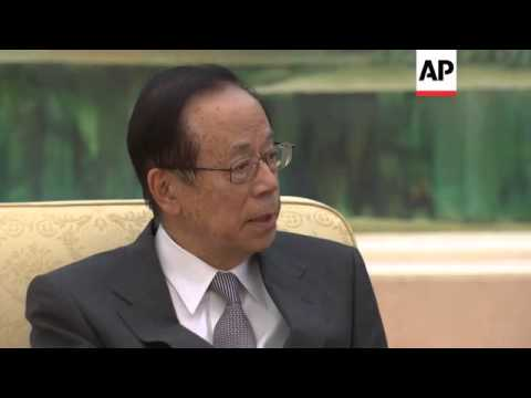 Former Japanese Prime Minister Yasuo Fukuda meets Chinese President Xi Jinping