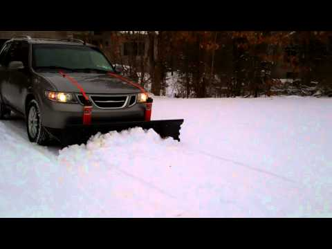 Nordic V Plow On A Gravel Driveway Pushed By A Small Car