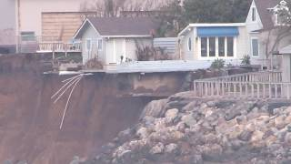 Erosion  in Pacifica: Houses about to fall into the ocean, trail destroyed.