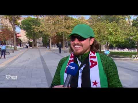 سوري يشارك بماراثون اسطنبول ويرفع علم الثورة  - 23:20-2017 / 11 / 13