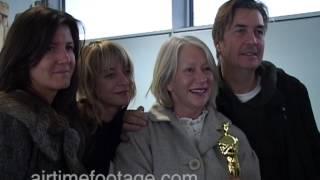 Helen Mirren flies back to Heathrow with Oscar