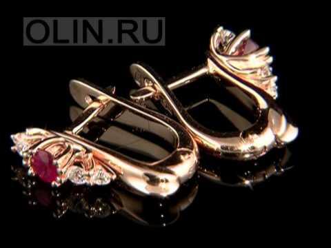 Золотые сережки с изумрудами или сапфирами