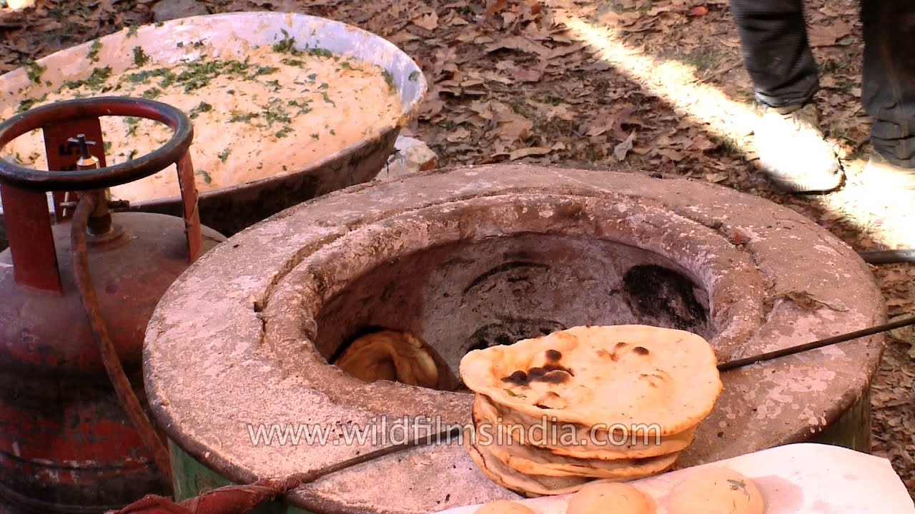Roti being cooked in a tandoor & Roti being cooked in a tandoor - YouTube