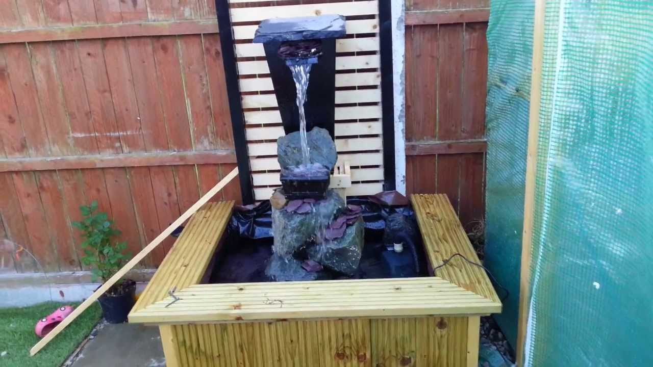 Diy my garden small waterfall first test run youtube for Wooden pond waterfalls