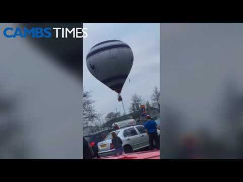 WATCH: Police rescue pilot after hot air balloon floats over Tesco car park - Cambs Times