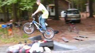 kid jumps 4 kids on a bmx and bails really bad