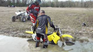 Bill sinking his rm 125 in a small mud hole and trying to get it out