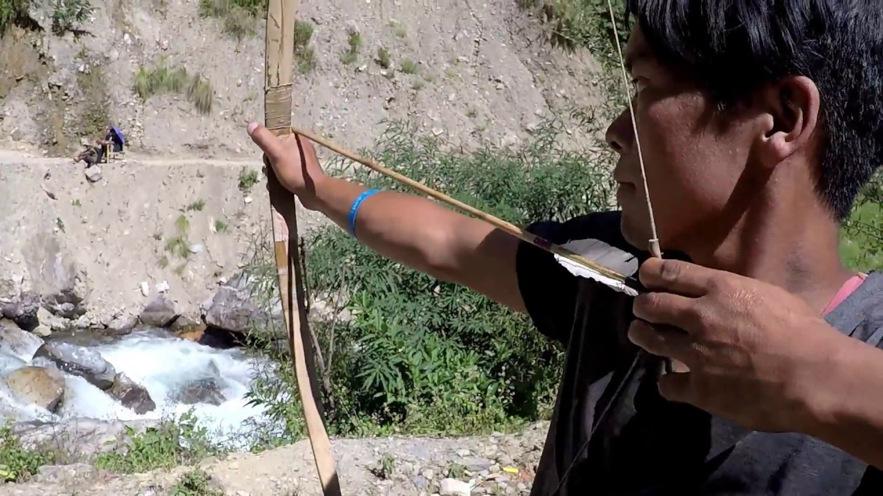 PLAYING BOW AND ARROW IN NEPAL   तारा खेल ।