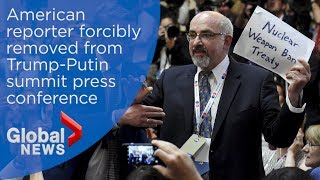 Reporter dragged from Trump-Putin press conference