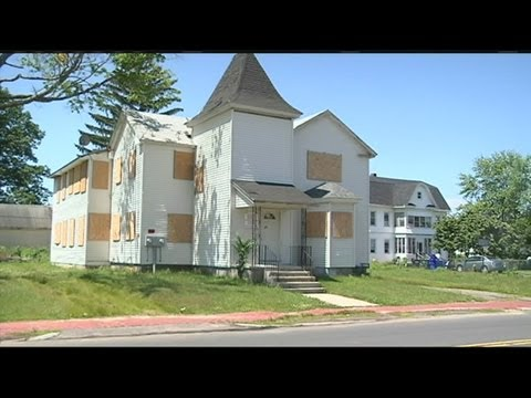 City defending property auctions