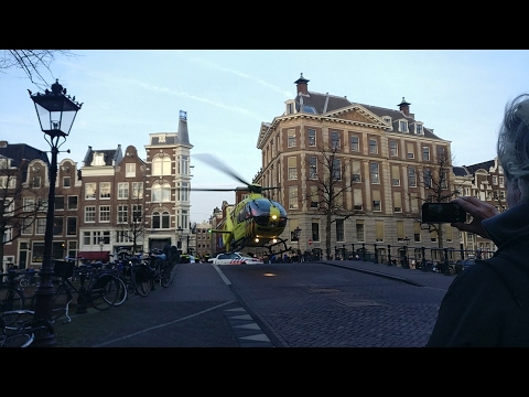 Emergency Helicopter takes off of Canal bridge in Amsterdam