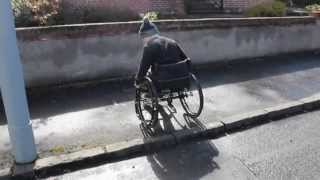 How to get up and down curbs, pavements, side walks in a wheelchair (Tutorial)