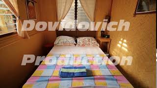 Interior inside an inexpensive room in a cheap hotel in Asian countries. In the room there is a