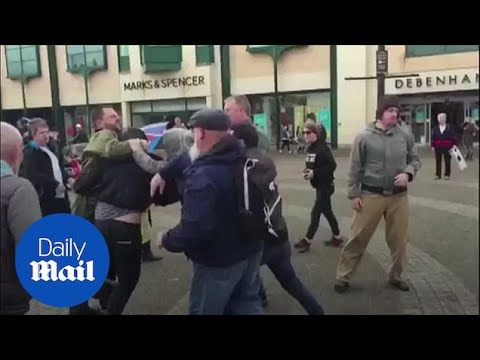 Scuffle After Protesters Attempt To Throw Milkshake At Ukip Candidate Carl Benjamin
