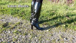 Walking in Patent high heeled boots