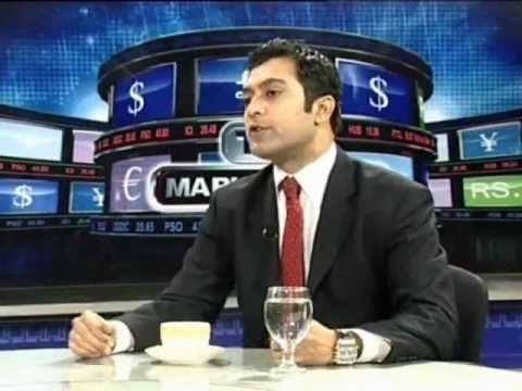 TARIQUE KHAN JAVED DISCUSSING DECLINE IN WORLD ECONOMY WITH SAYEM ALI OF SCB