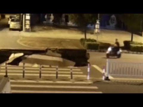 Motorcyclist plunges into sinkhole after road collapses in China