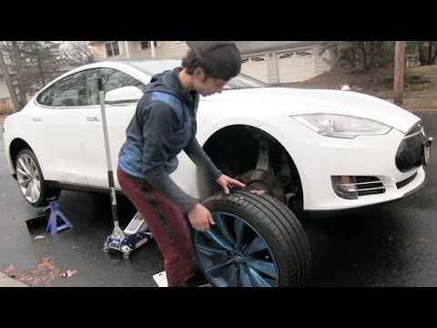 15 Year Old Fixes A Flat Tire On A Tesla For The First