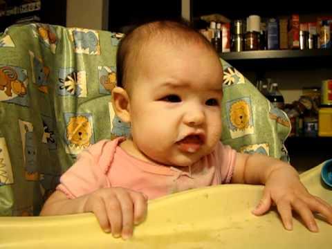 Raini gagging and eating baby oatmeal