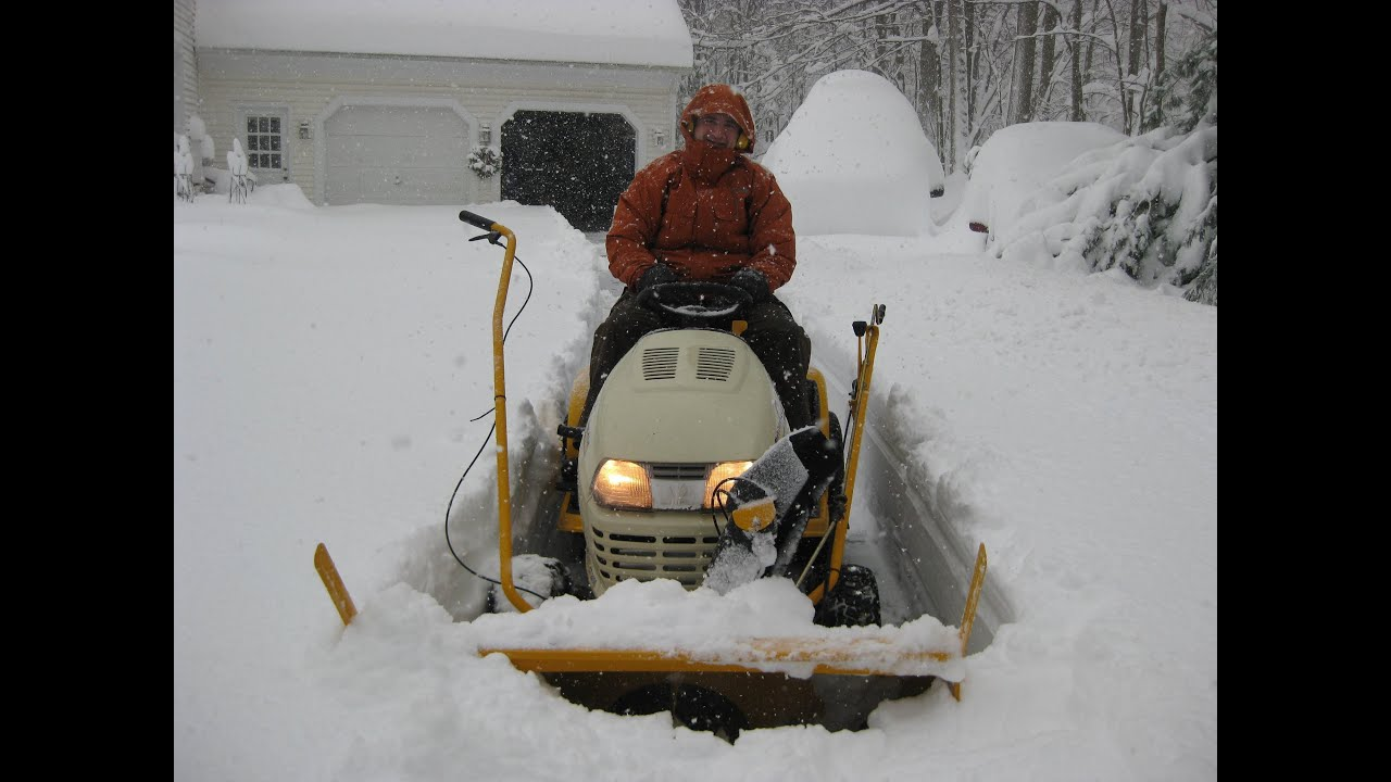 hight resolution of cub cadet tractor mounted snow thrower operating