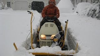 cub cadet tractor mounted snow thrower operating
