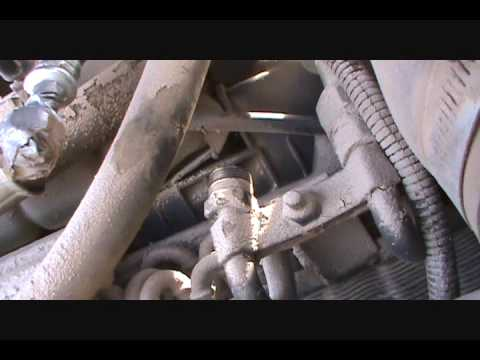 Air conditioner hose replacement on 7410 johnn deere.wmv