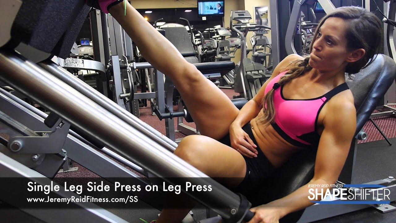 Girl locks legs on leg press
