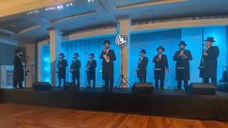 Motty Illowitz & Lev Choir Sharing The Stage At an Evant For Kapayim Organization
