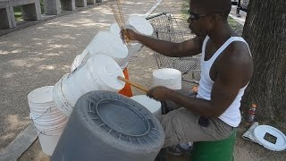 Street musician bucket drummer in Washington, D C