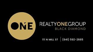 Realty ONE Group Black Diamond Ribbon Cutting in Lake Mills, Iowa