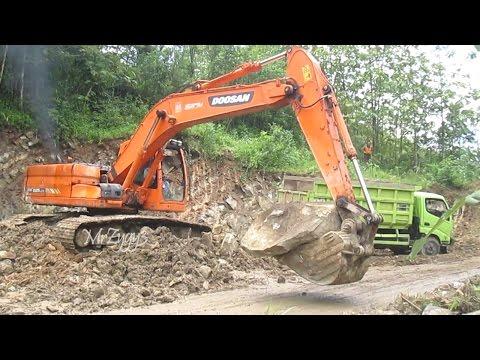 Doosan DX225LCA Excavator Loading Dump Truck