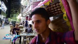 الأسر تلجأ لشارع العريش بعد تحوله إلى سوق شعبية.. والباعة: موسم و«كله بيرزق».. فيديو وصور