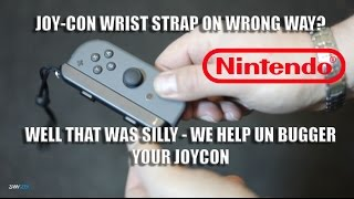 How to Remove Joy-Con Wrist Strap Stuck On The Wrong Way - Nintendo Switch