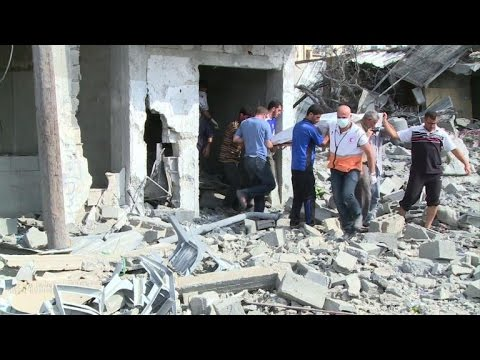 Gaza residents walk through rubble during truce