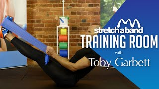 Trainingsvideo Sit Up en V-Sit oefening met fitness elastiek. Stretchaband resistance bands