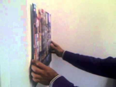 Apprendre fixer un tableau au mur doovi for Apprendre a peindre un mur