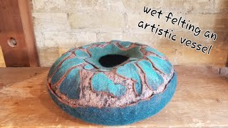 Hand felted vessel / sculpture with cutaway resist